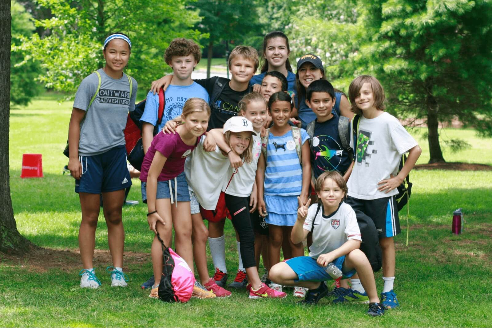 Group of campers smiling with their counselor