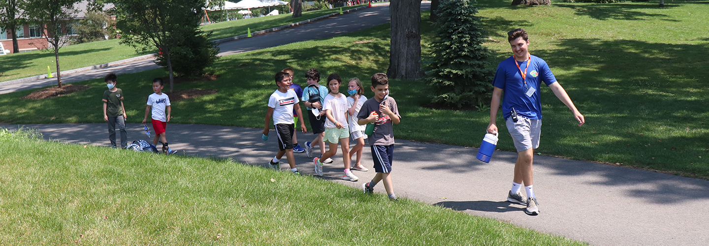 Group of campers walking and cheering.